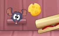 Numa casa cheia de ratos um gato est� a guardar o queijo. Felizmente o gato est� a dormir e o queijo redondo facilmente desliza para fora das suas patas quando clicares sobre ele. Faz o teu melhor para fazer o queijo atingir o pequeno rato! Tenta acertar em todas as estrelas amarelas, por exemplo, com a ajuda de trampolins. Podes remover os blocos de madeira, mas tamb�m podes coloc�-los de volta, clicando sobre eles.