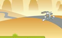 O camião das cenouras perdeu a sua carga! Ajuda o Bugs a apanhar todas as cenouras que caíram do camião.  Quando os inimigos te aparecem no ressalto, podes saltar sobre eles ou saltar para cima deles.  Diverte-te!